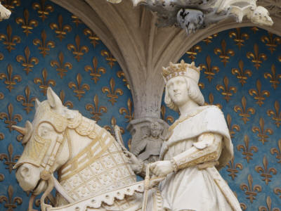 Statue of Louis XII King of France, with horse and fleurs de lys, at the Royal Wing